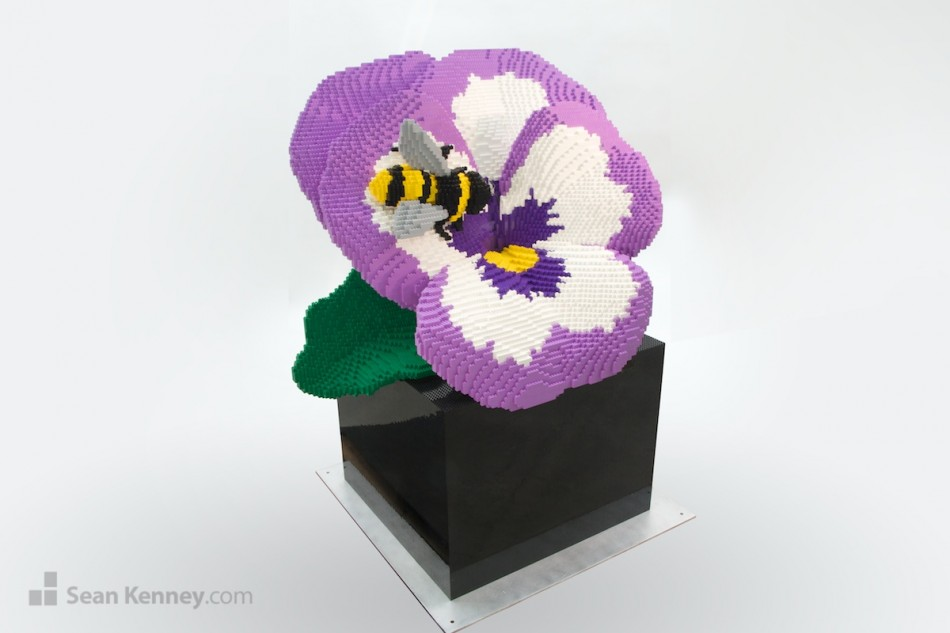 Pansy-and-bee LEGO art by Sean Kenney