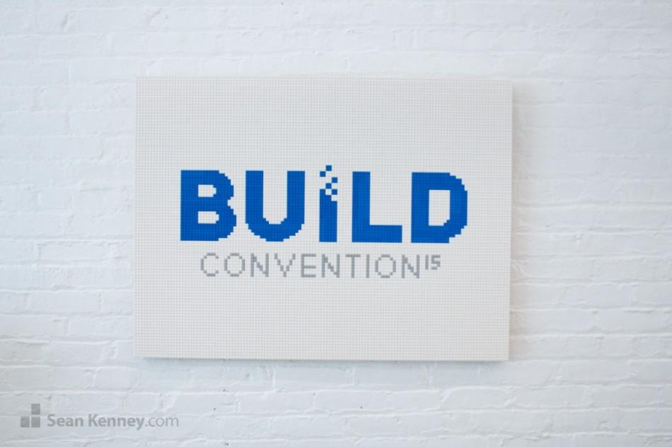 Build-logo LEGO art by Sean Kenney