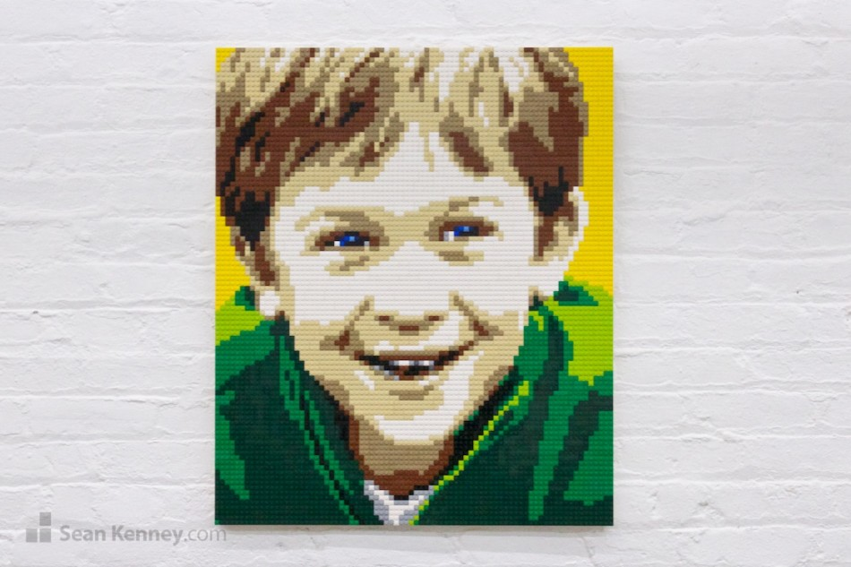 Boy-in-green-shirt LEGO art by Sean Kenney