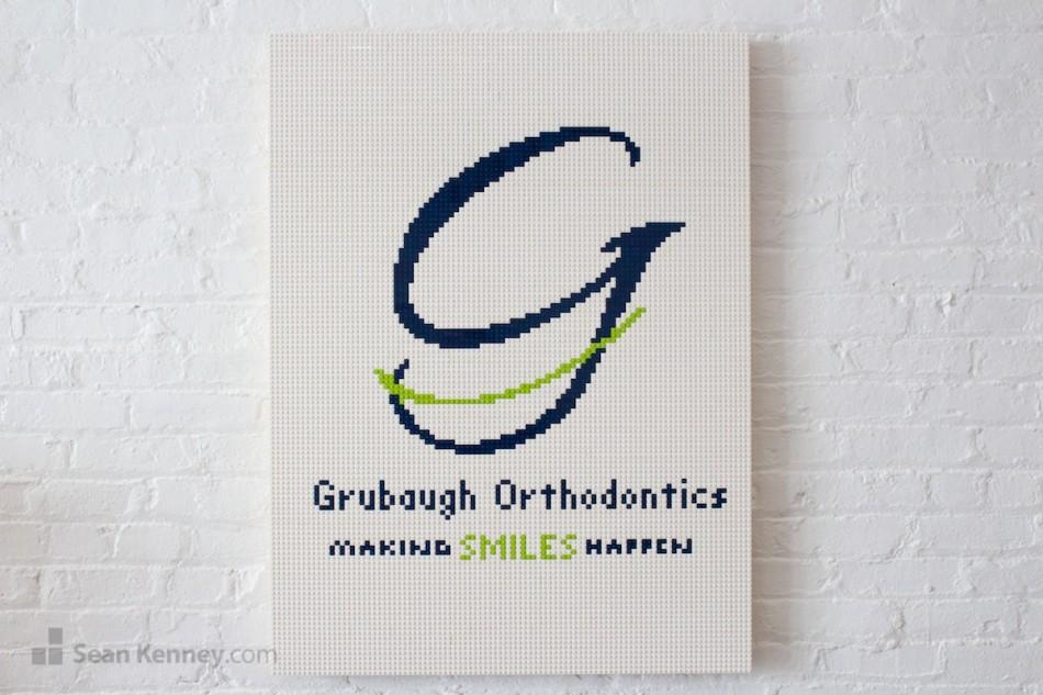 Grubaugh-orthodontics-logo LEGO art by Sean Kenney