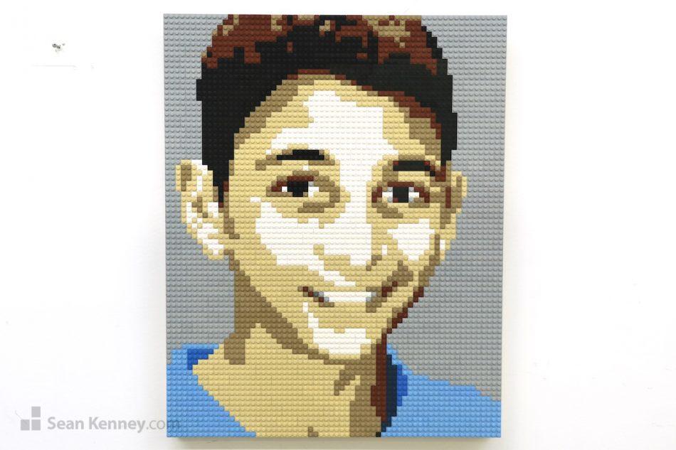 Boy-in-a-blue-shirt LEGO art by Sean Kenney