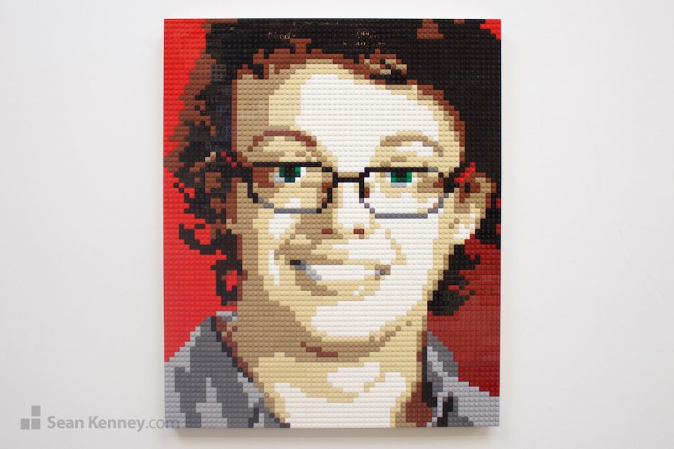 Boy-with-curly-hair-and-glasses LEGO art by Sean Kenney