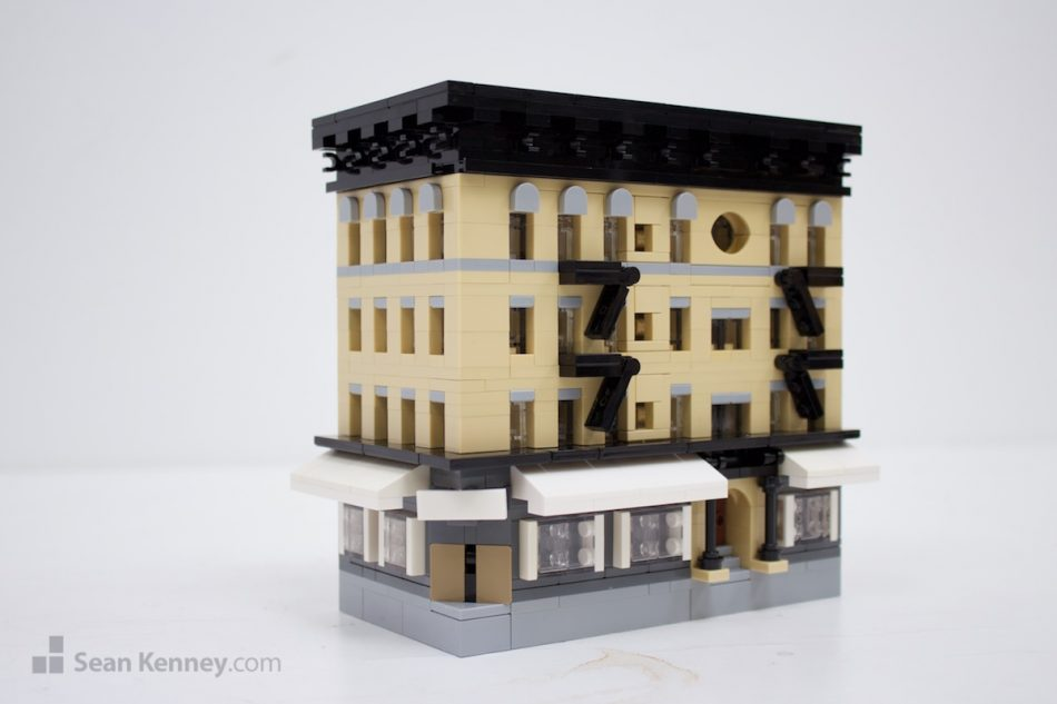 Not-quite-building-on-bond LEGO art by Sean Kenney