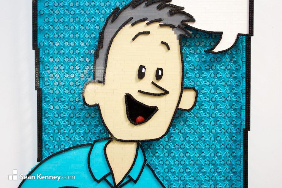 Cartoon-self-portrait LEGO art by Sean Kenney