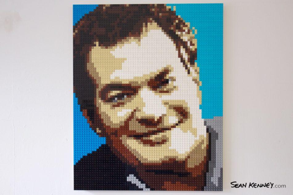 Father-on-blue LEGO art by Sean Kenney